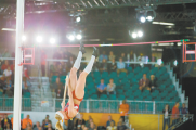 Greenville pole vaulter Sandi Morris floats through the air, approaching a bar set 15 feet, 11 inches in the air. Morris cleared the bar and finished in second place at the 2016 IAFF World Indoor Championships in Portland, Ore. [CREDIT: Wilder]